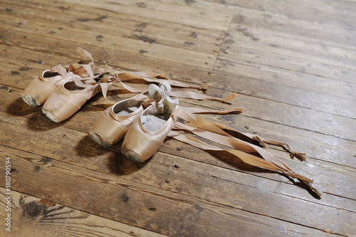 shabby ballet pointe closeup on a wooden background