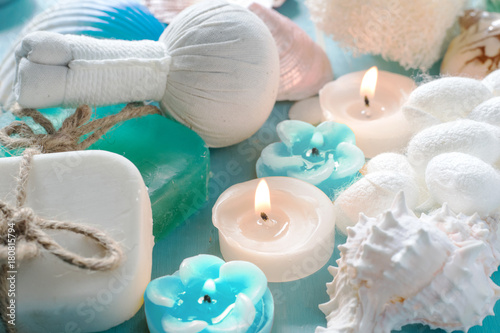 Plexiglas Plumeria ocean blue spa products soap candle compress herbal ball and silk cocoon for scrub on blue wood background with copy space , ocean breeze fresh aroma concept