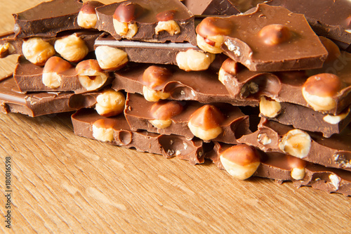 Foto op Plexiglas Kiev Dark and milk chocolate with hazelnut on a wooden background