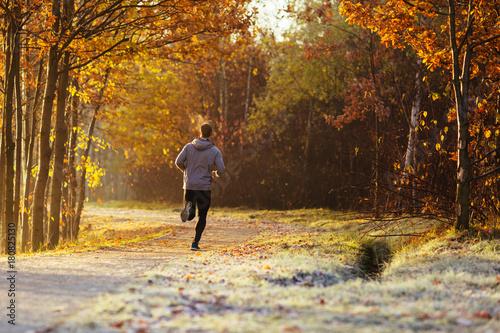 Fotobehang Hardlopen Man running outdoors on cold autumn morning