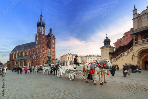 Horse carriages at the Main Square in Krakow, Poland