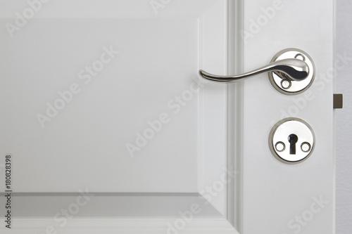 Metallic door knob on a classic white door. Home | Buy Photos | AP ...