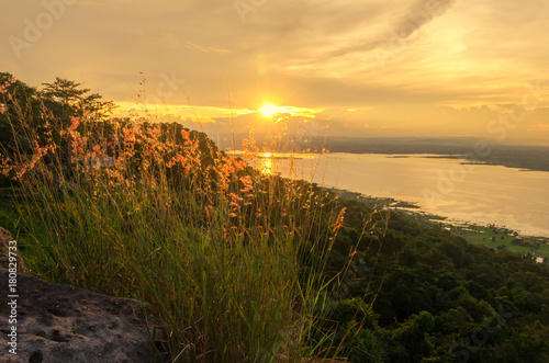 Fotobehang Jacht Sunset and mountains,Beautiful sunset,sunlight reflects the water surface and the grass is on mountains