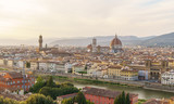 Florence city panorama with Arno river and Santa Maria del Fiore cathedral at sunset.