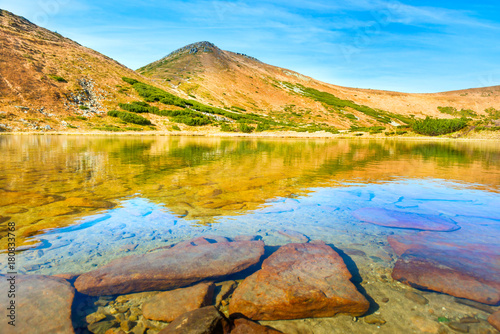 Foto op Canvas Honing Blue lake in the mountains