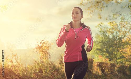 Fotobehang Hardlopen Beautiful young woman running at the lake