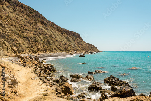 Poster Cyprus A rocky coastline view in Pissouri Bay not far from the tourist beach, Cyprus