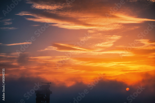 Foto op Canvas Zee zonsondergang Panoramic view toward sea port and industrial cranes