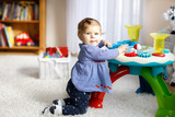 Adorable cute beautiful little baby girl playing with educational toys at home or nursery. - 180844787