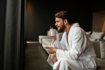 Handsome man relaxing drinking tea