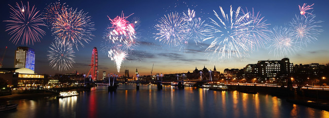 London skyline, night view, fireworks over Hungerford Bridge and Big Ben