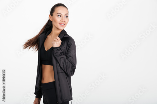 Poster Happy young sports lady running isolated