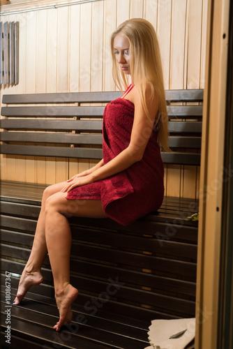 Pretty blonde enjoying a steam bath alone