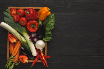 Border of fresh vegetables on wooden background with copy space