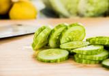 cutting  cucumber on board