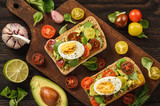 Bruschetta with avocado, egg and tomatoes. - 180875569