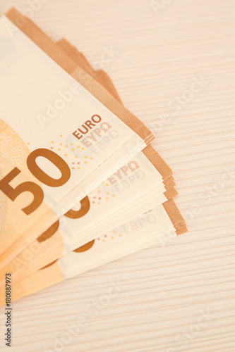 Poster euro banknotes of fifty denominations on the table.