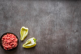 Composition of raw meat with vegetables and spice on wooden background - 180896305