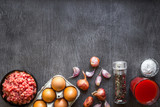 Composition of raw meat with vegetables and spice on wooden background - 180896368
