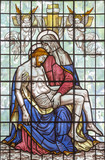 LONDON, GREAT BRITAIN - SEPTEMBER 16, 2017: The Pieta on the stained glass in St Clement Danes from 20. cent. - 180896765