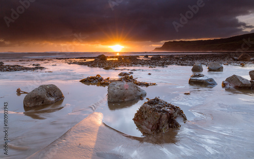 Foto op Plexiglas Diepbruine Boggle Hole at Sunrise, Jurassic coast Yorkshire, England, uk
