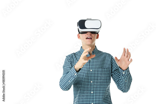 Young boy in virtual reality goggles on white background