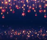 Balls And Christmas Lights Hanging On Dark Background - 180914972