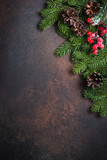 Fir tree pine cones and decorations on dark stone table. - 180920912