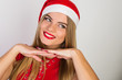 Quadro Portrait of an attractive woman wearing Santa's hat on a white background.