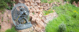 Tantric Deities statue in Ritual Embrace located in a mountain garden - 180928756