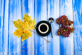 Still Life - A cup of black coffee with a cluster of grapes