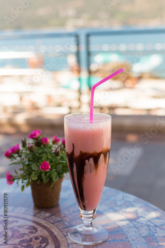 Foto op Aluminium Milkshake Delicious milk dessert with chocolate and strаwberry on ceramic table and blurred background
