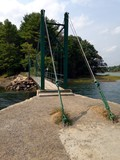 a small suspension foot bridge over the bay in york harbor - 180935123