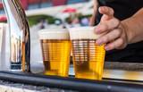 Serving cold beer at a street food market