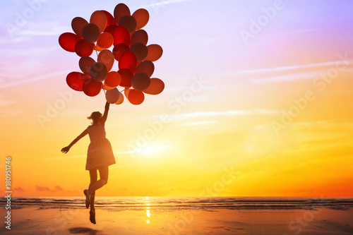 happiness or dream concept, silhouette of happy woman jumping with multicolored Poster