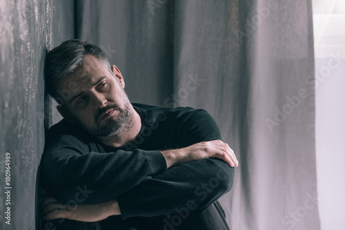 Sad man during autumn weather