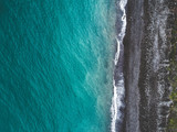 Aerial view of sea shoreline and dark pebble beach. View from above. - 180971389