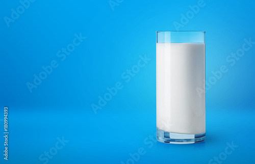 Poster Glass of milk on blue background