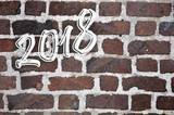 2018 written on red brick  wall