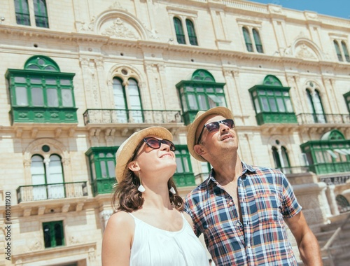 Sticker Young tourists couple sightseeing in Valletta, Malta