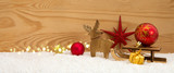 Christmas background with wood deer and red ball on sledge.