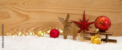 Fotobehang Hert Christmas background with wood deer and red ball on sledge.