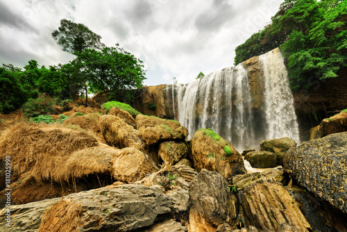 Bottom view of waterfall among green woods. Beautiful landscape - 181025998