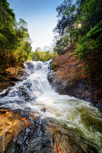 Foto op Plexiglas Diepbruine Scenic view of the Datanla waterfall with crystal clear water