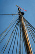 Vintage ship mast and ropes with modern navigation