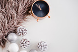 White Christmas background. Faux fur, rose gold clock, frosty pine cones, silver and white colored decoration balls. Minimalistic style. Copyspace for text, overhead, horizontal - 181050365