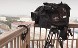 Professional digital video camera. professional camcorder on the shooting of the cityscape. - 181065396