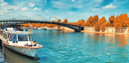 Paris, panoramic image of passenger ship on Seine river in Autumn