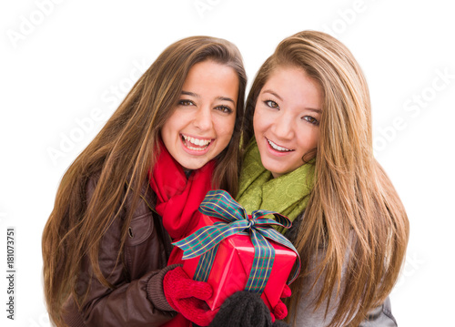 Mixed Race Young Adult Females Holding A Christmas Gift Isolated on a White Background Poster