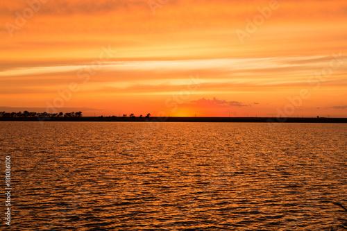 Papiers peints Orange eclat Sunrise on the lake. Sunset on the lake.